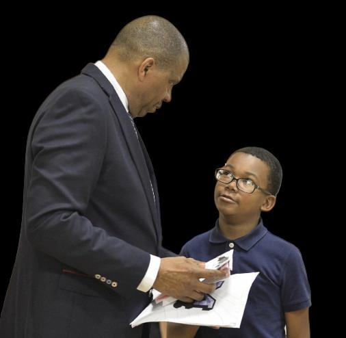 coach tim brown mentoring a school aged boy